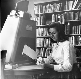 Student using microfilm in Library