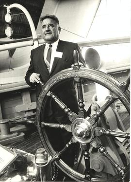 President Mortvedt's Norway trip, man at ship wheel