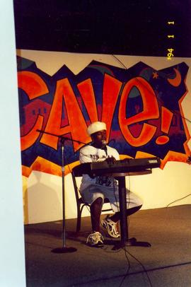 Student keyboardist performing in the Cave