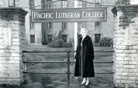 Woman at campus entrance