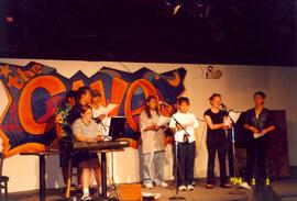 Group of students performing in the Cave