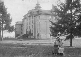 Old Main and three students