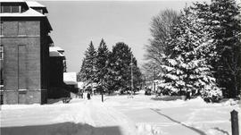 Side view of Old Main in snow