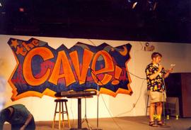 Student performing in the Cave